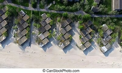 beach with houses on the coastline - beach with wooden...