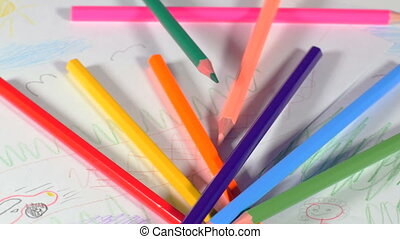 Pencils and children's pictures - Wooden pencils scattered...
