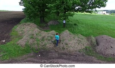 girl practicing shooting at targets in countryside, aerial...