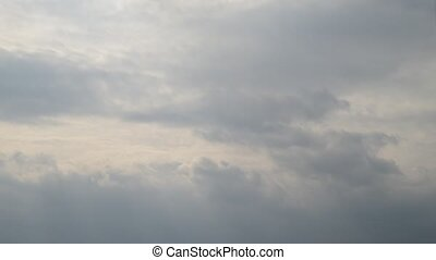motion of clouds in overcasted sky, video - motion of rainy...