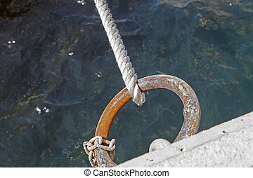 nautical rope at the pier ring for anchor