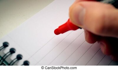 Hand writing I LOVE YOU U with red marker in notepad with...