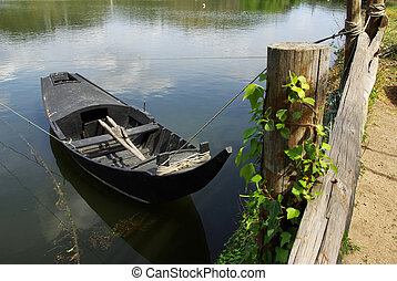 Row Boat on the shoreline - Countryside landscape with old...
