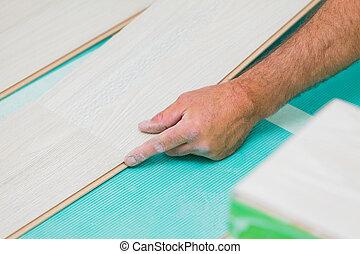 Flooring renovation - Handyman renovating house, installing...