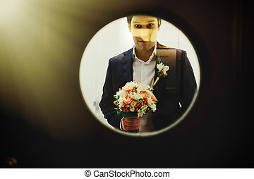 View on the groom through the round window