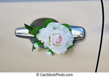 white rose flower on the handle of a car in wedding day
