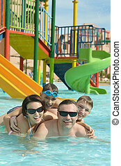 parents with two sons in aqua park
