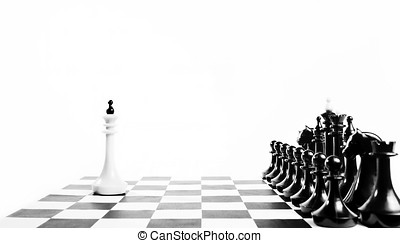 Alone white chess king in front of enemy team. Unequal...
