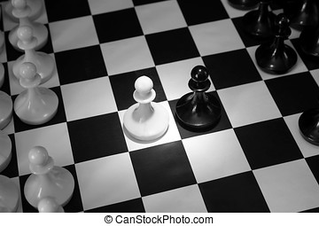 Two chess pawns one opposite to other. Beginning of battle. Concept with chess pieces on chessboard