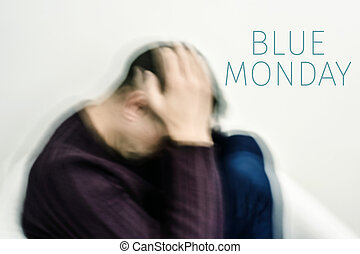 sad man and text blue monday - closeup of a blurred young...