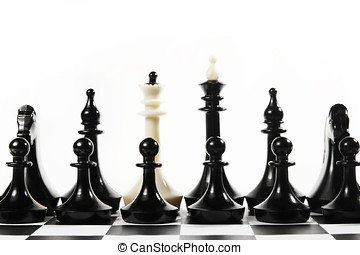 White queen in the set of black chess pieces. Concept of...