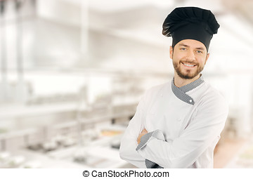 happy smiling chef standing in kitchen. copy space