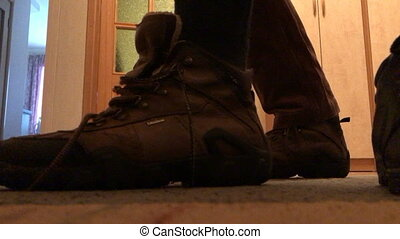 Man clothes and lace up winter boots close-up