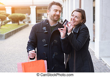 Couple in shopping time - Man holding a credit card ready...