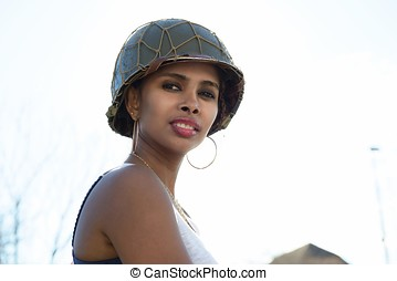 beautiful young woman with ww2 military helmet - beautiful...