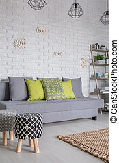 Sofa and upholstered stools - Living room with sofa and...