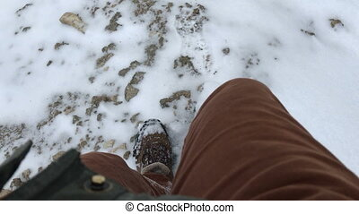 feet men down from the mountain in the snow. POV video
