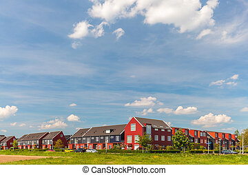 Newly built Dutch contemporary red family houses - Newly...