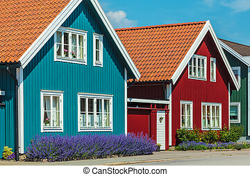 Old swedish houses in front of a blue sky - Ancient colorful...