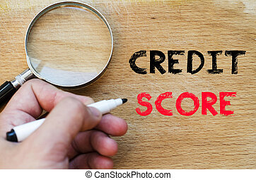 Credit score text concept - Human hand over wooden...