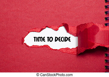 The word time to decide appearing behind torn paper