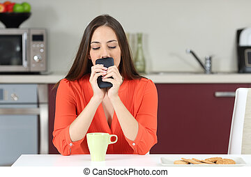 Doubtful woman wondering if she must call on phone -...