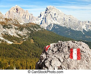 Larch wood, tourist sign and Le Tofane Gruppe, Dolomiti,...