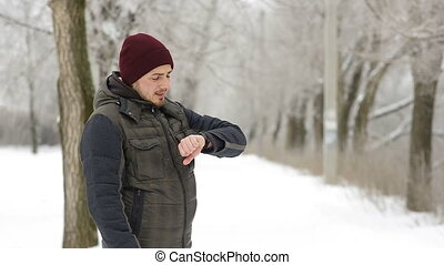 A man meets a brother in the winter in the park, which is much too late