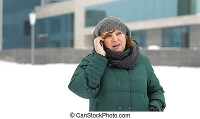 Grown woman calling by phone in the city