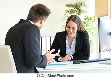 Salesman selling to a client at office - Salesclerk talking...