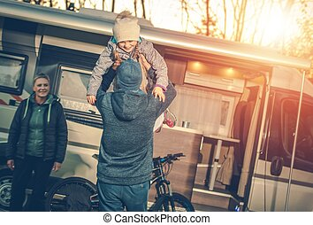 Family Camping Time. Young Family with Kid and Camper...