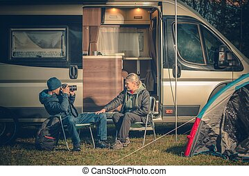 RV Camping Couples Fun - Young Couples Having Fun on the...
