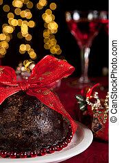 Plum pudding and christmas tree - Christmas dinner table...