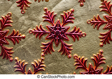 Red snowflakes on a gold background