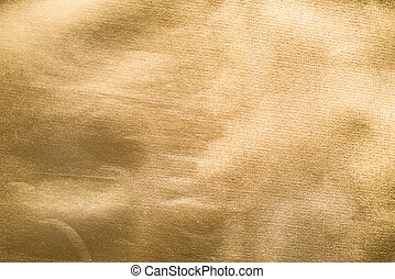 Old gold paper. Golden texture Uneven background with the...