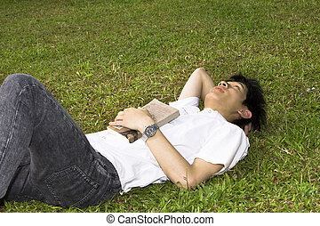 asia man relax on the grass