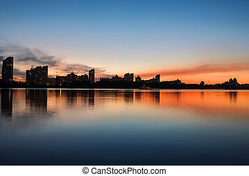Cityscape: Moscow brindge and Obolon district in the evening. Kiev. Ukraine. East Europe