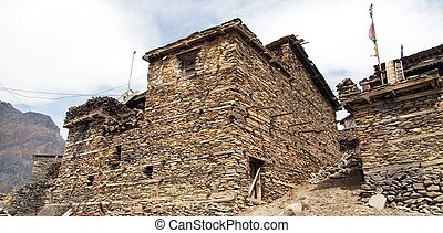 View of local stony building in Upper Pisang village one of...