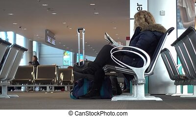 People on terminal seats waiting for flight - People wait...