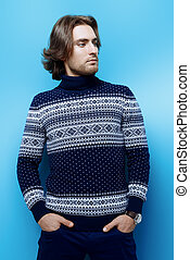 men pullover - Handsome young man wearing sweater over blue...
