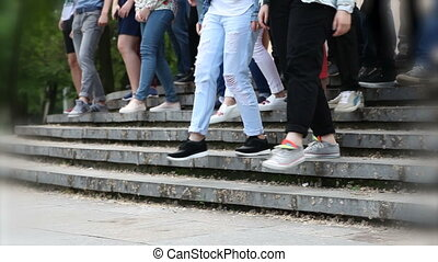 People descend the stairs - People go down the stairs in the...