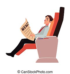 Businessman reading newspaper in business class airplane seat
