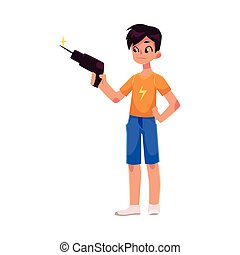 Full length portrait of teenage boy holding a drill