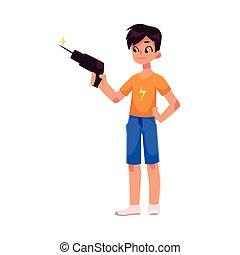 Full length portrait of teenage boy holding a drill