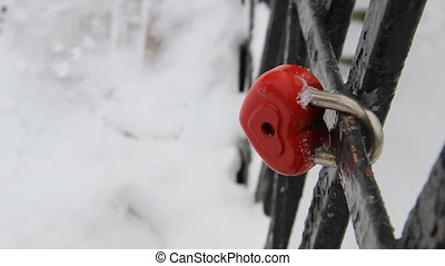 heart-shaped lock, symbol of love, in winter time with copy...