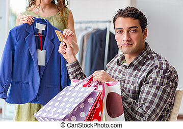 Man getting into debt due to shopping
