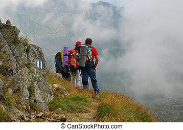 Tourist on Carpathian mountain trail - Tourist sighting the...