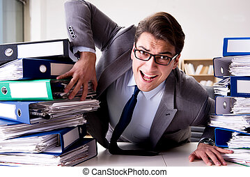 Businessman under stress due to excessive work