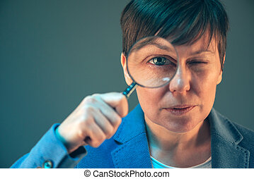 Female tax inspector with magnifying glass
