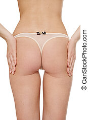 Cellulite - Bum of woman checking out if her bum slim...